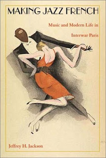 book cover featuring a man and a woman dancing, dressed in styles from the 1920s