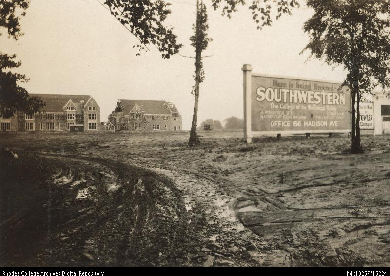 "An old photo of a muddy construction site with a few buildings in the background and a sign in the middle ground that reads, ""Here is being erected: Southwestern The College of the Mississippi Valley"""