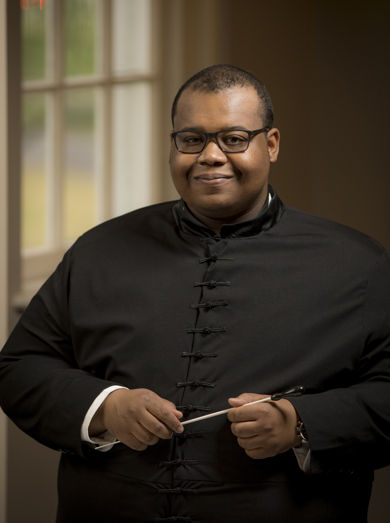 image of African American man with a conductor's wand