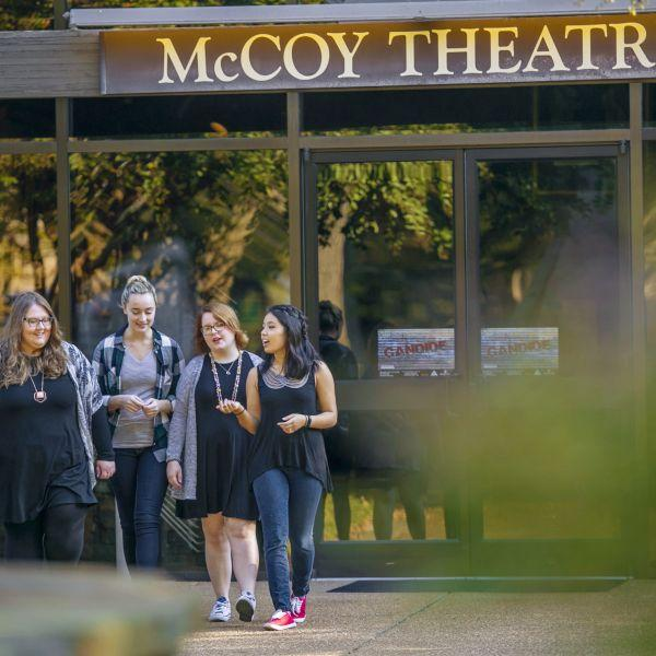 A line of students walk outside the McCoy Theatre