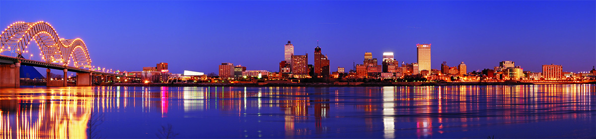The skyline of downtown Memphis looking back from the middle of the river at dusk.