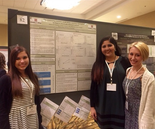 Students in front of a poster presenting research