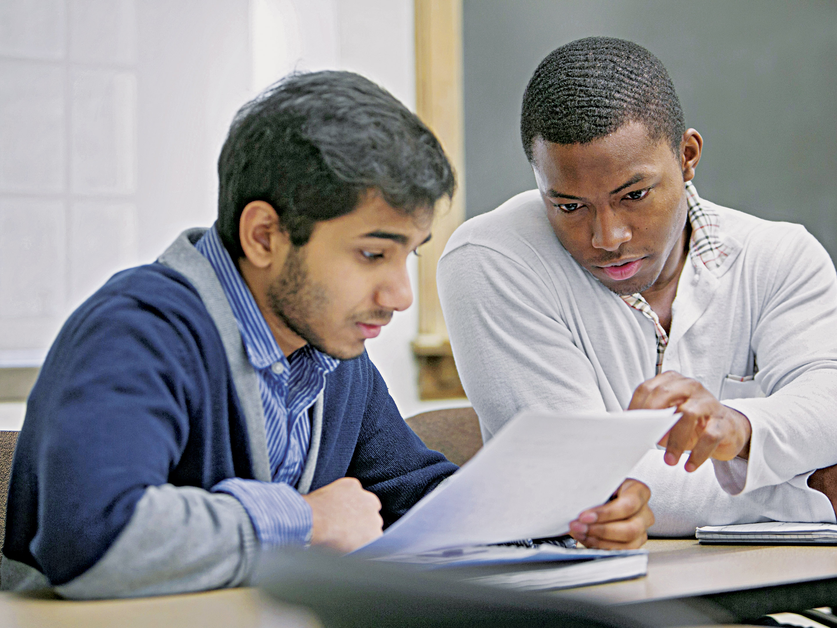 2 male students studying