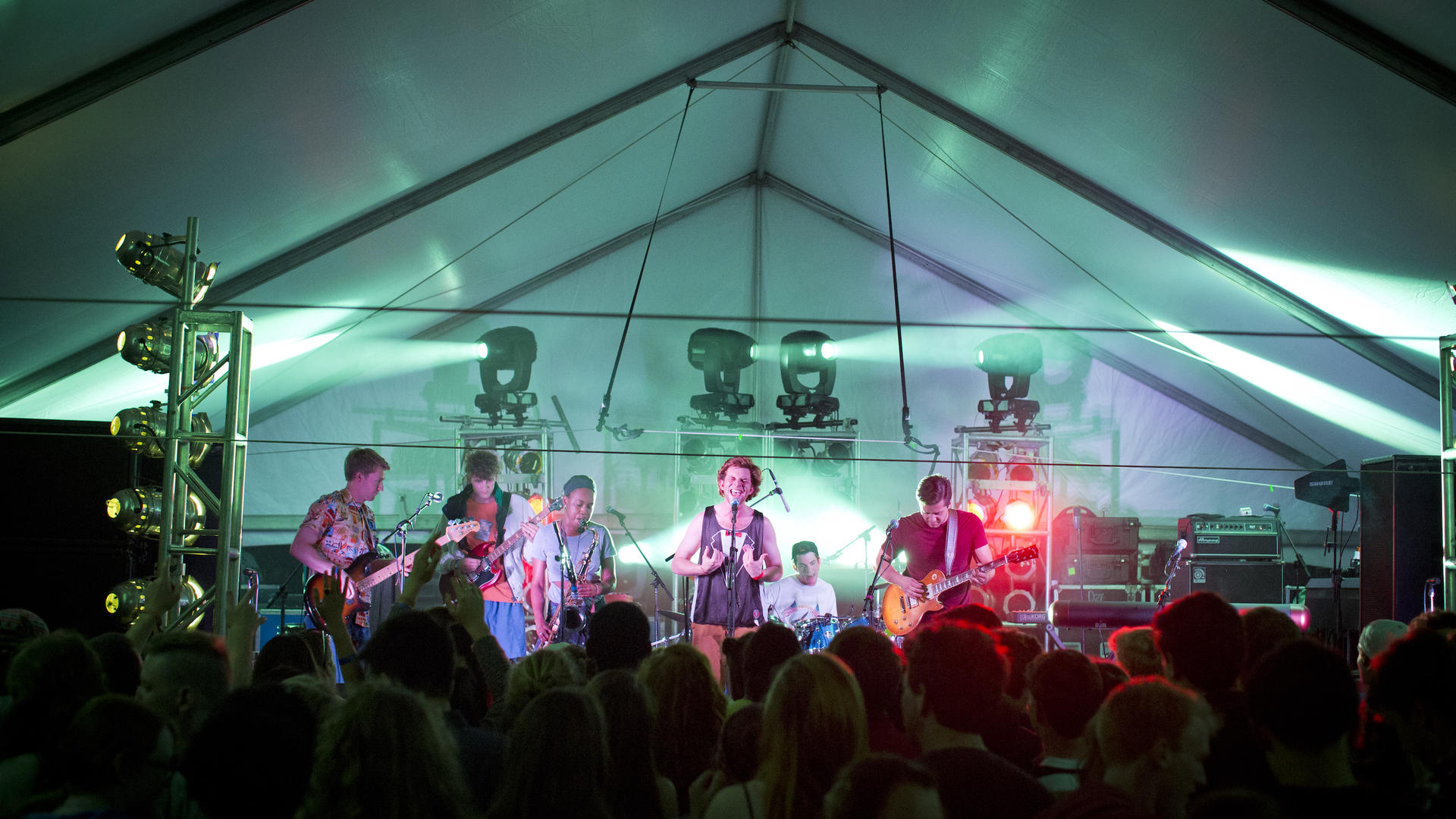 a band performs under a tent