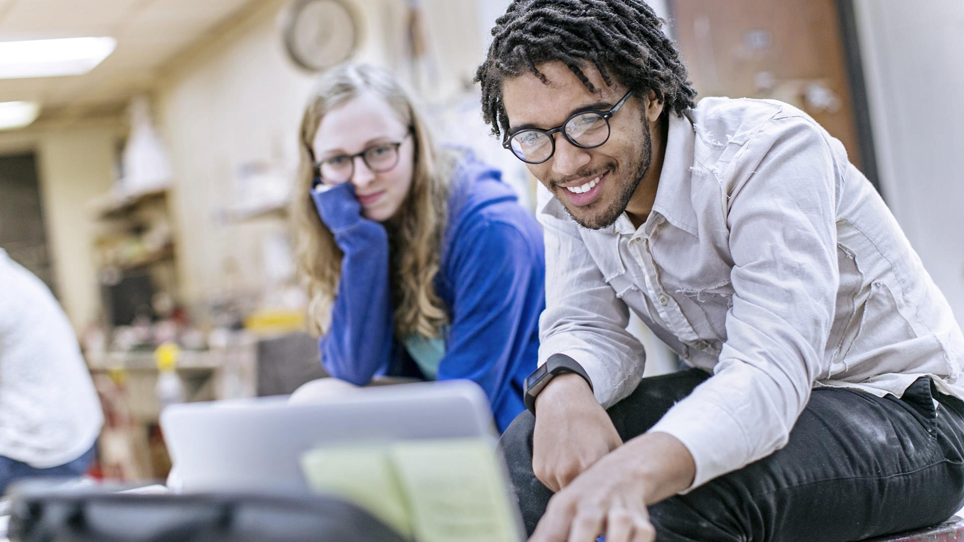 two students look at a computer