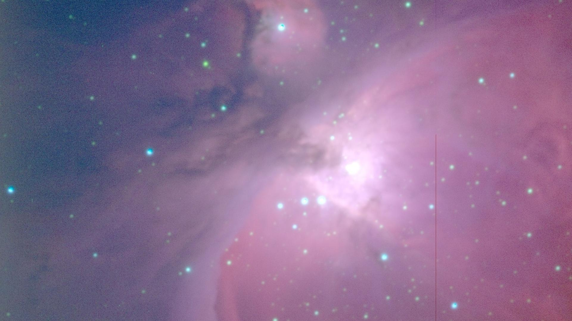 Bright purples and blues swirl in the Orion Nebula