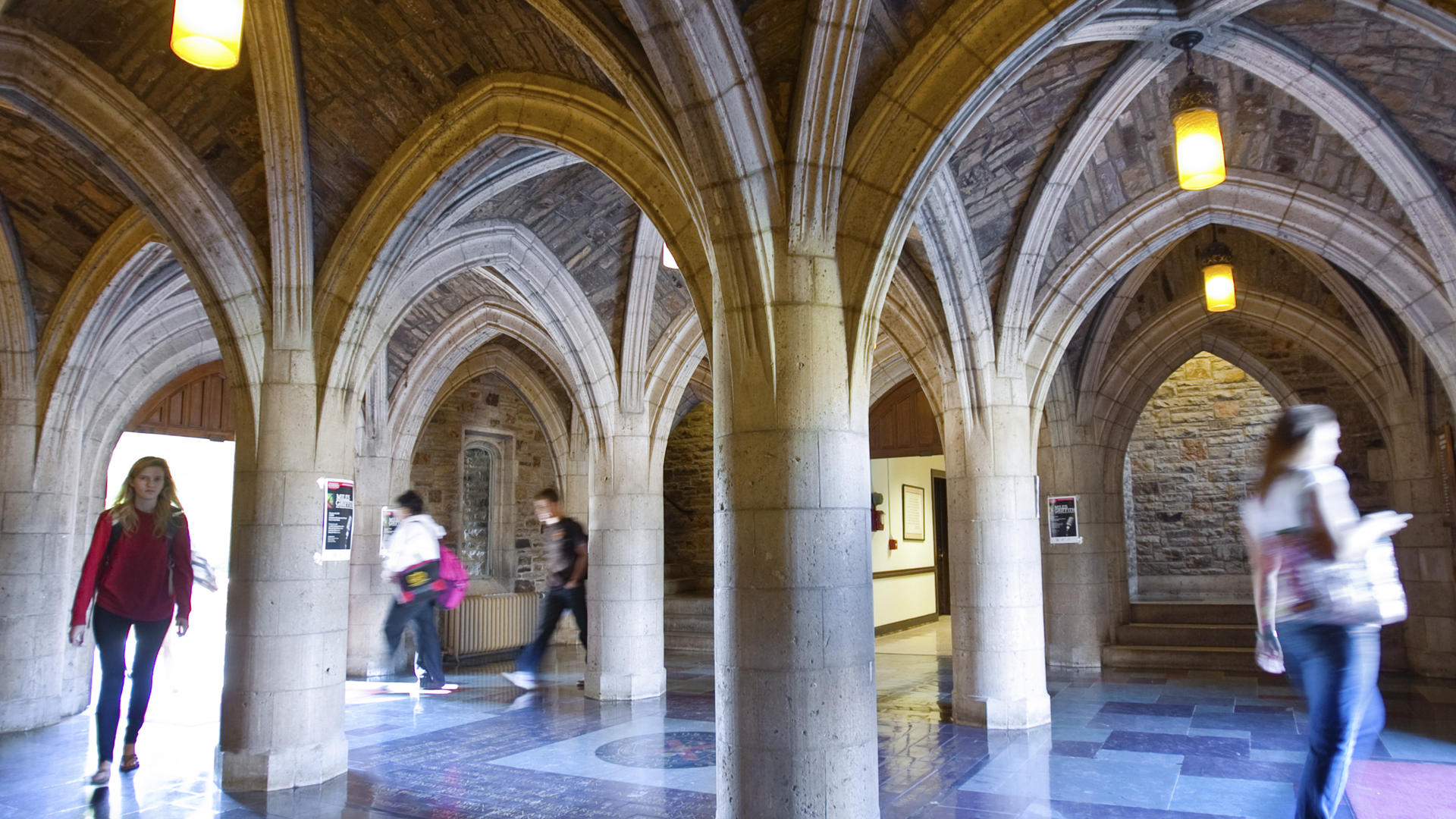 Students come in and out of the Southwestern Hall cloister
