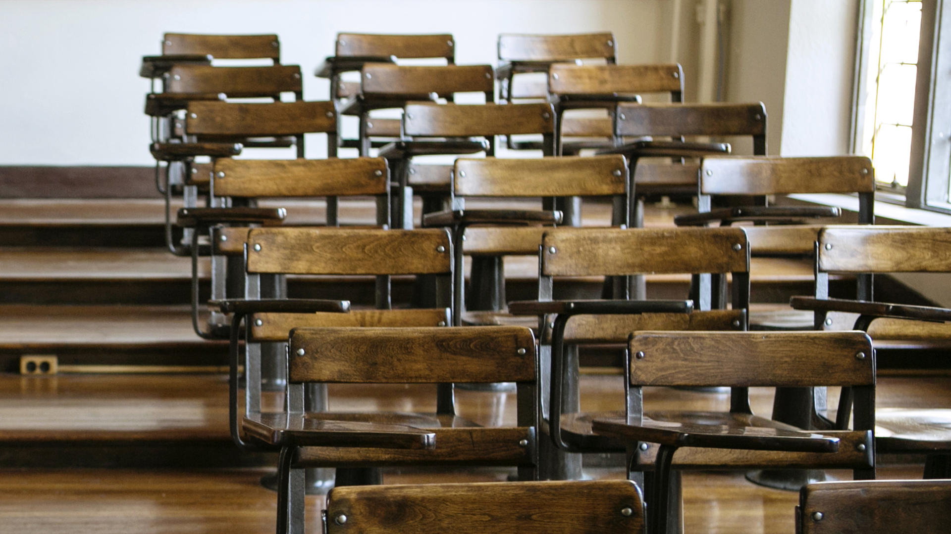 Empty lecture hall chairs