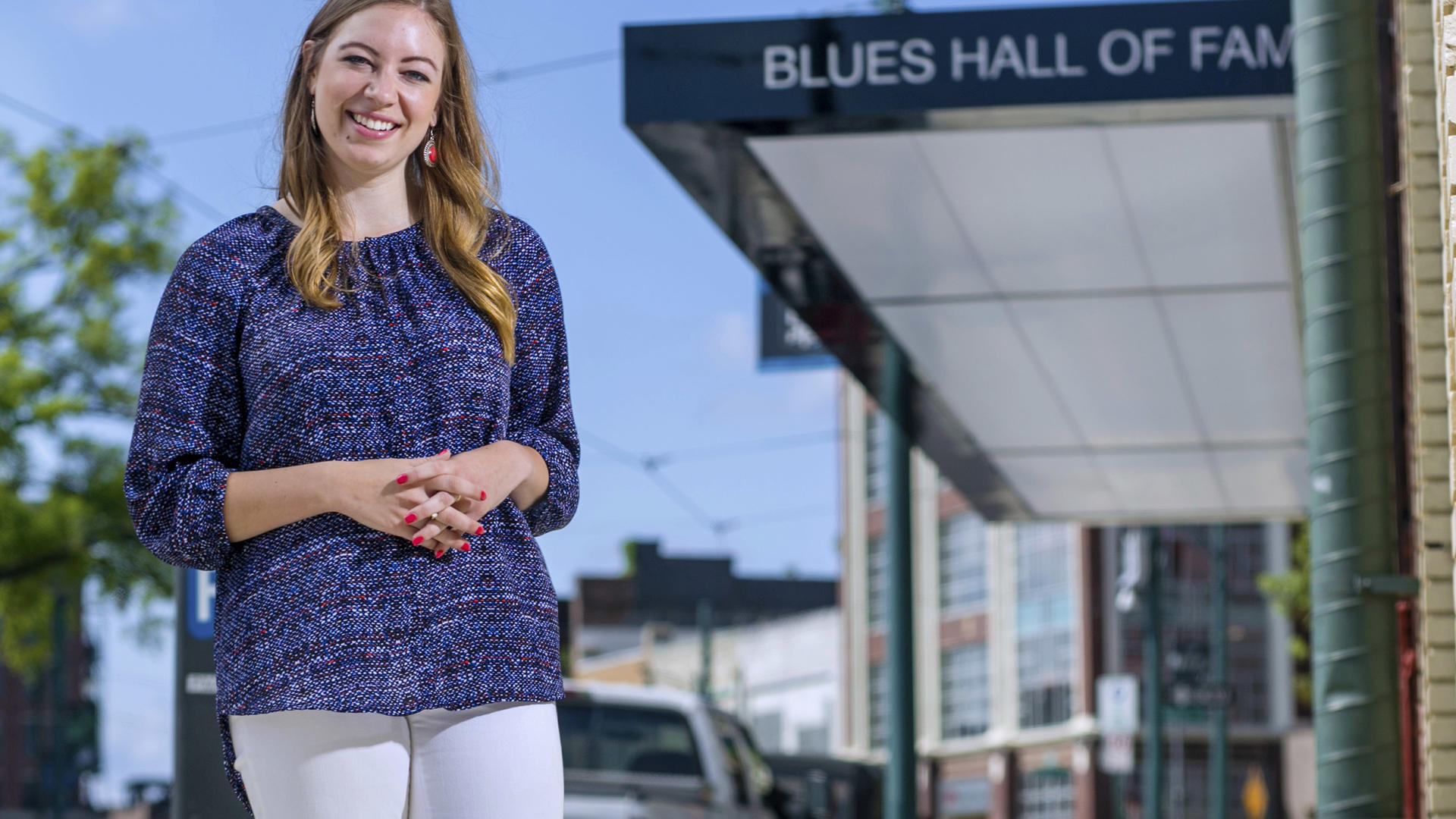 a student standing outside the blues hall of fame