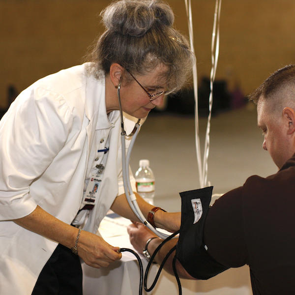 A student getting their blood pressure measured