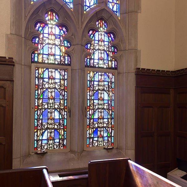 stained glass windows and a church pew