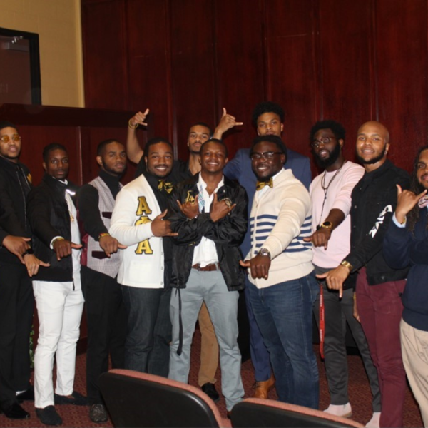 Several men, some wearing Alpha Phi Alpha letters
