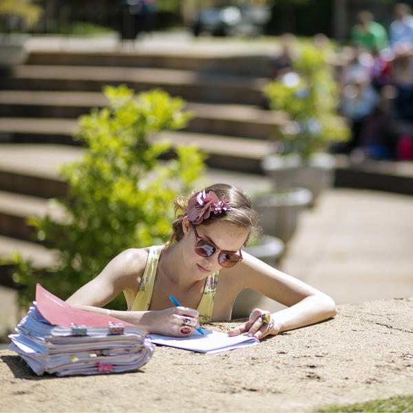 a female student studying outside