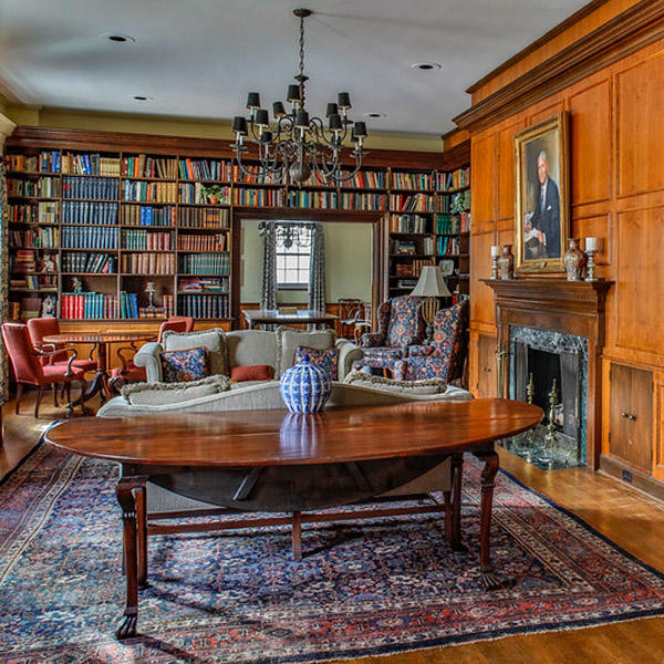 a formal room with walls lined in bookshelves
