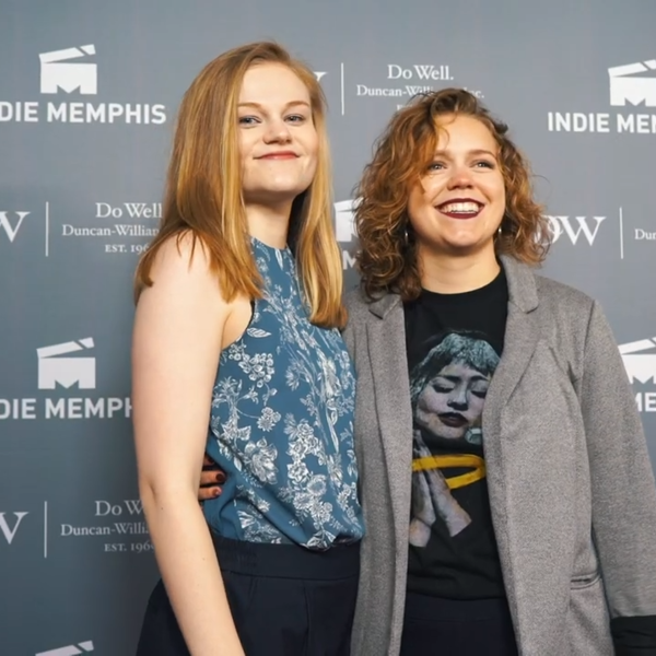 Two young women take to the red carpet at a film festival.