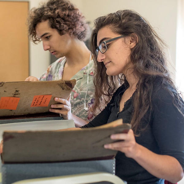 two students look at manuscrips