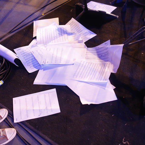 a pile of sheet music strewn about