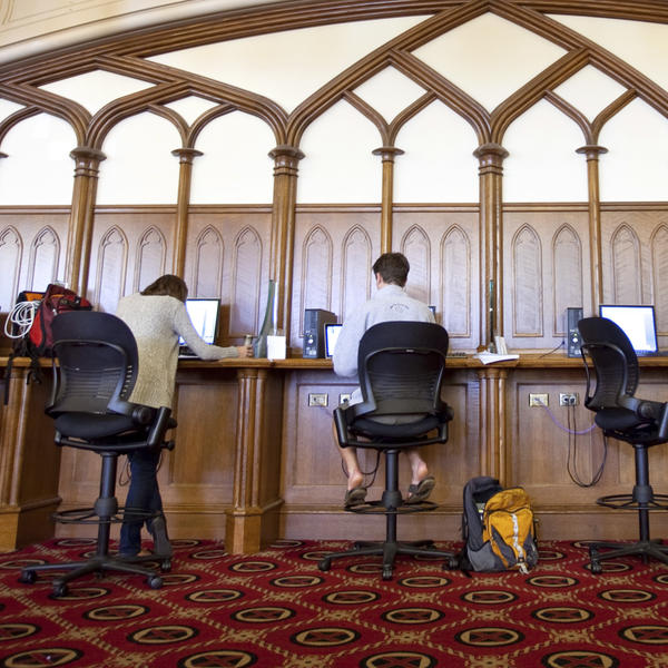 students sitting at computers in the library