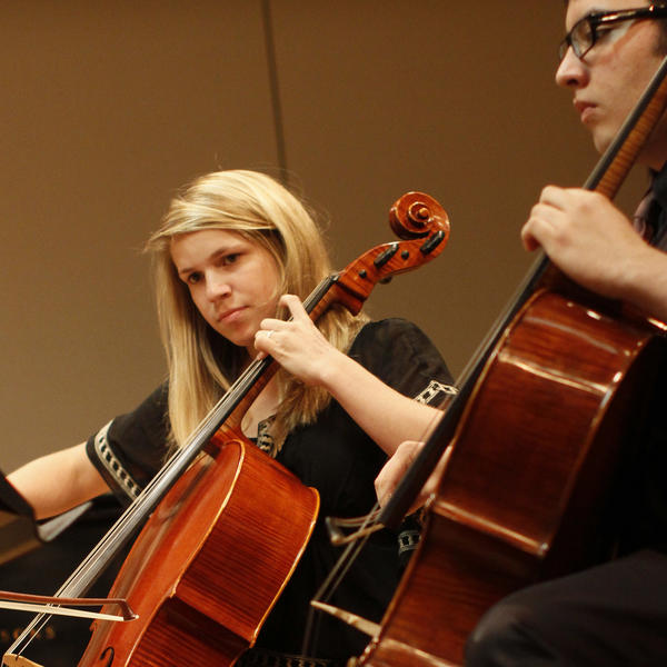 two students play cellos