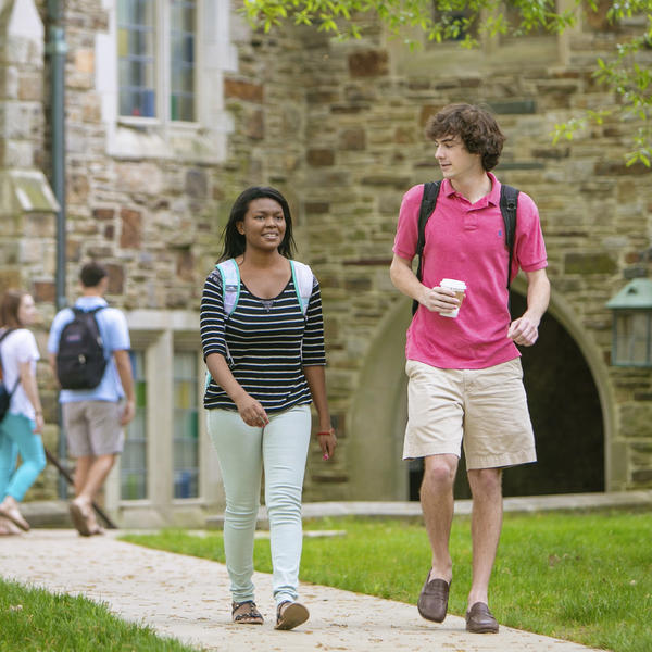Students walking and talking on a sidewalk